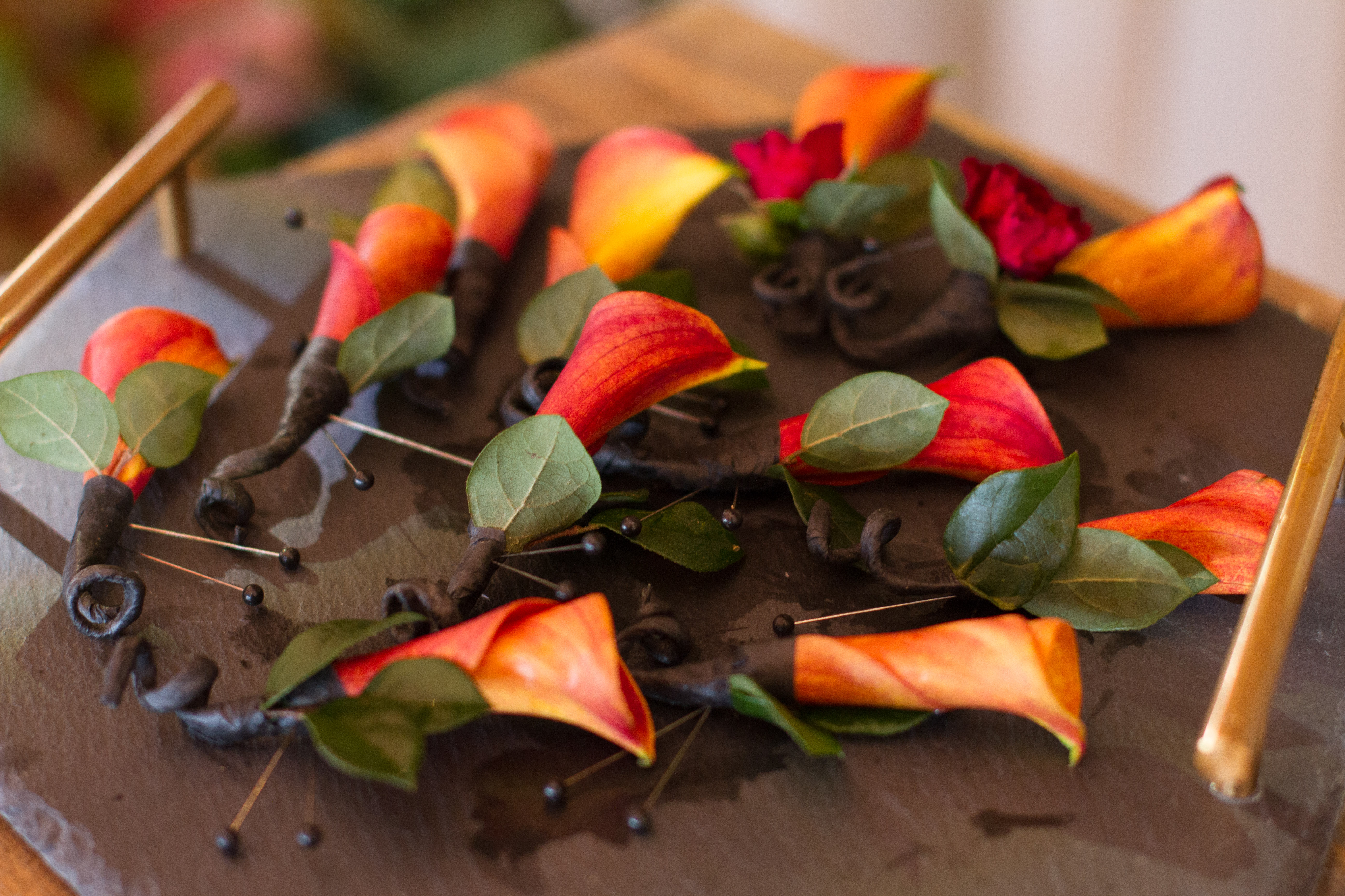 Mini Orange Calla Lily Fall Wedding Boutonniere from Topher Mack Floral & Events in Atlanta